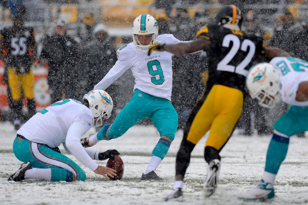. Miami Dolphins kicker Caleb Sturgis (9) kicks a field goal in the first quarter of an NFL football game against the Pittsburgh Steelers in Pittsburgh, Sunday, Dec. 8, 2013. (AP Photo/Don Wright)