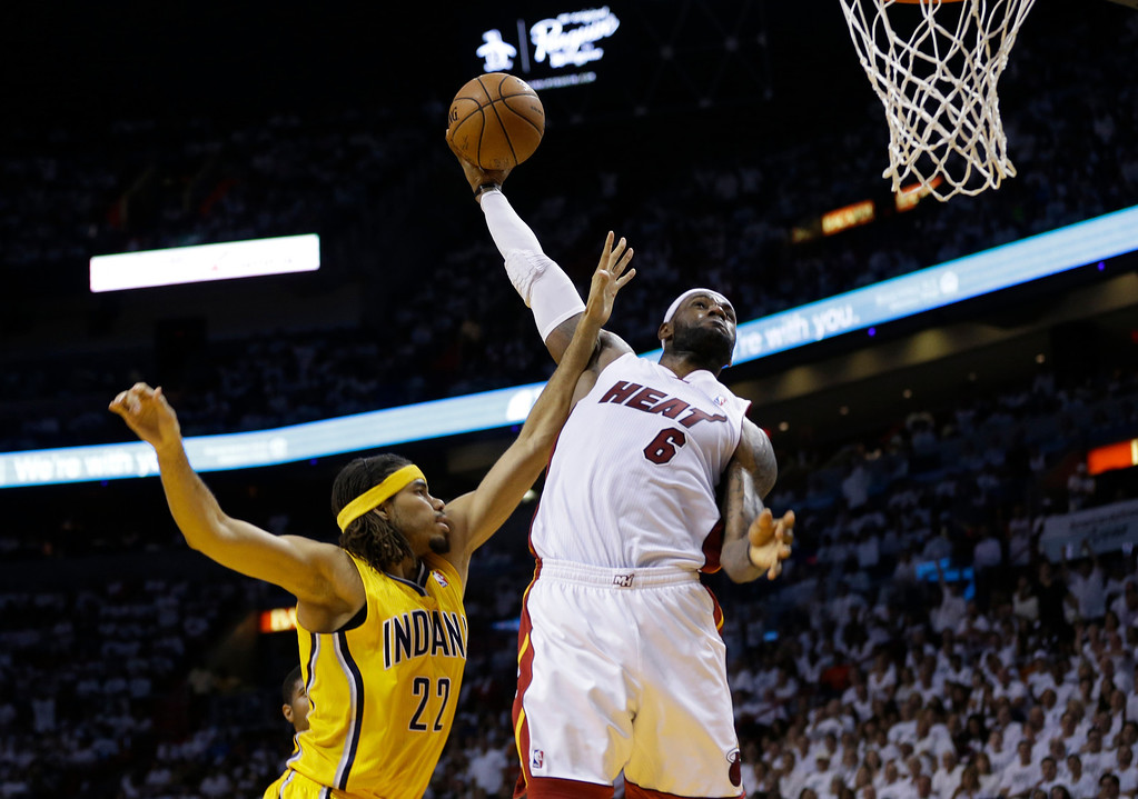 . Miami Heat forward LeBron James (6) drives to dunk the ball over Indiana Pacers forward Chris Copeland (22) during the second half Game 6 in the NBA basketball playoffs Eastern Conference finals on Friday, May 30, 2014, in Miami. (AP Photo/Lynne Sladky)