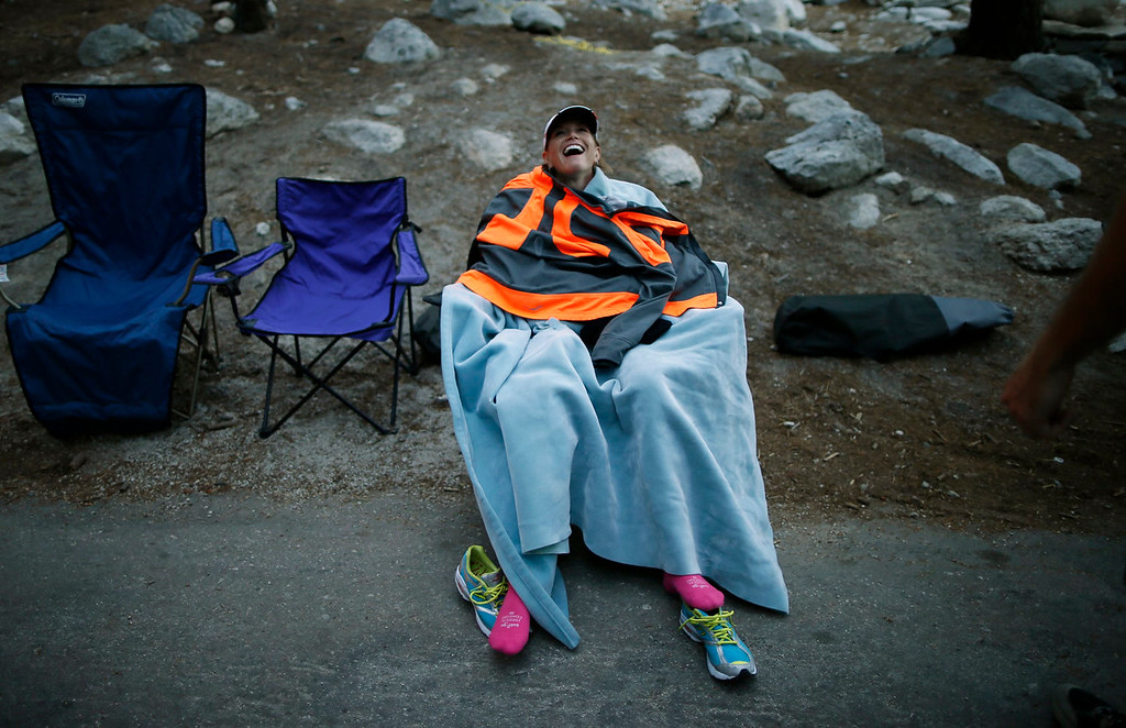 . Meredith Dolhare, 39, from North Carolina, laughs as she cools down after finishing the Badwater Ultramarathon at the foot of Mount Whitney, California July 16, 2013. The 135-mile (217 km) race, which bills itself as the world\'s toughest foot race, goes from Death Valley to Mount Whitney, California in temperatures which can reach 130 degrees Fahrenheit (55 Celsius). Picture taken July 16, 2013.  REUTERS/Lucy Nicholson