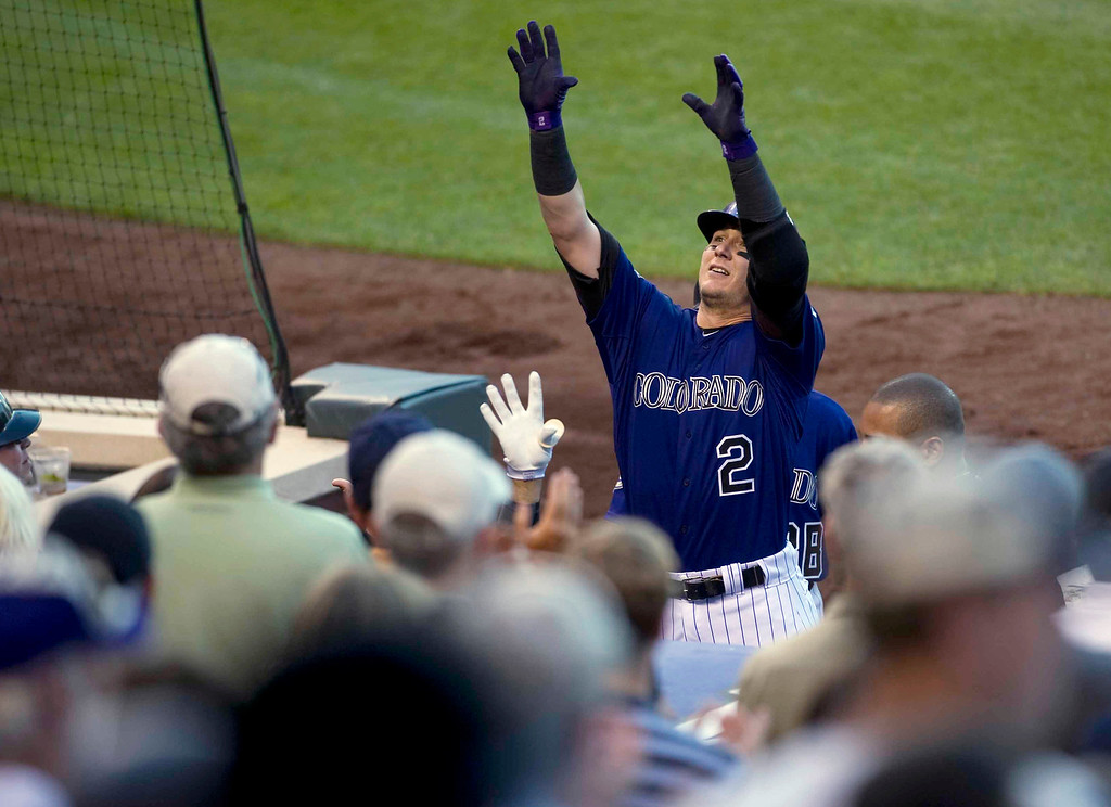 . Troy Tulowitzki #2 of the Colorado Rockies waves to the crowd after hitting a home run during the fourth inning of a Major League Baseball game against the Miami Marlins on July 22, 2013 at Coors Field in Denver. (Photo By Grant Hindsley/The Denver Post)