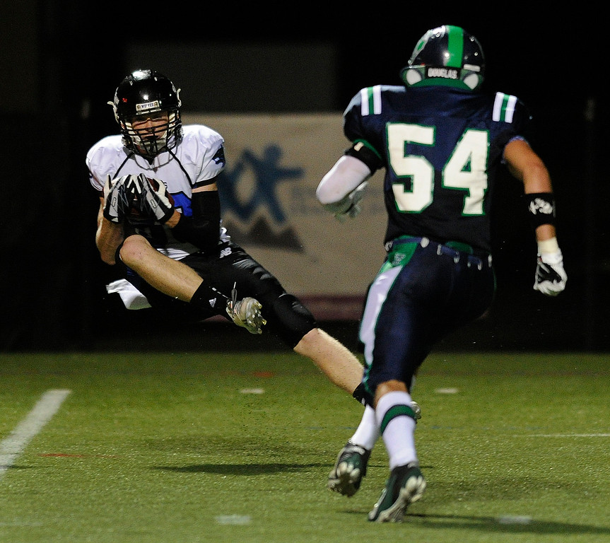 . HIGHLANDS RANCH, CO. - SEPTEMBER 13: Wolves receiver Trent Richardson (83) came down with a catch in the fourth quarter. The ThunderRidge High School football team defeated Grandview 21-7 at Shea Stadium Friday night, September 13, 2013.  Photo By Karl Gehring/The Denver Post