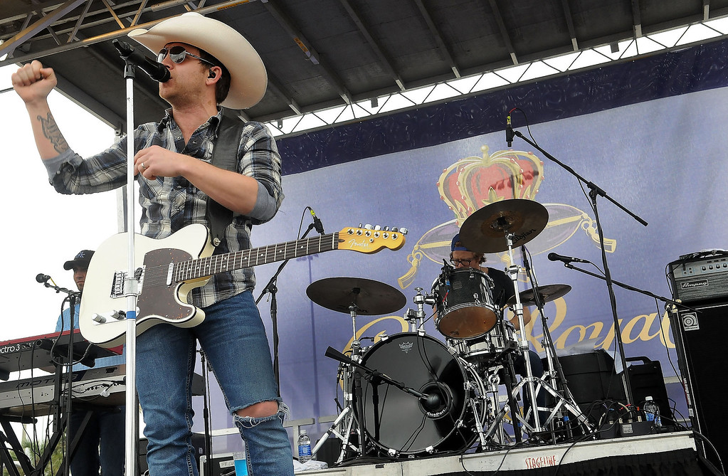 """. Justin Moore teams up with Crown Royal to launch their annual \""""Your Hero\'s Name Here\"""" program with a special concert prior to the Daytona 500 at Daytona International Speedway on February 24, 2013 in Daytona Beach, Florida.  (Photo by Gerardo Mora/Getty Images for Crown Royal)"""