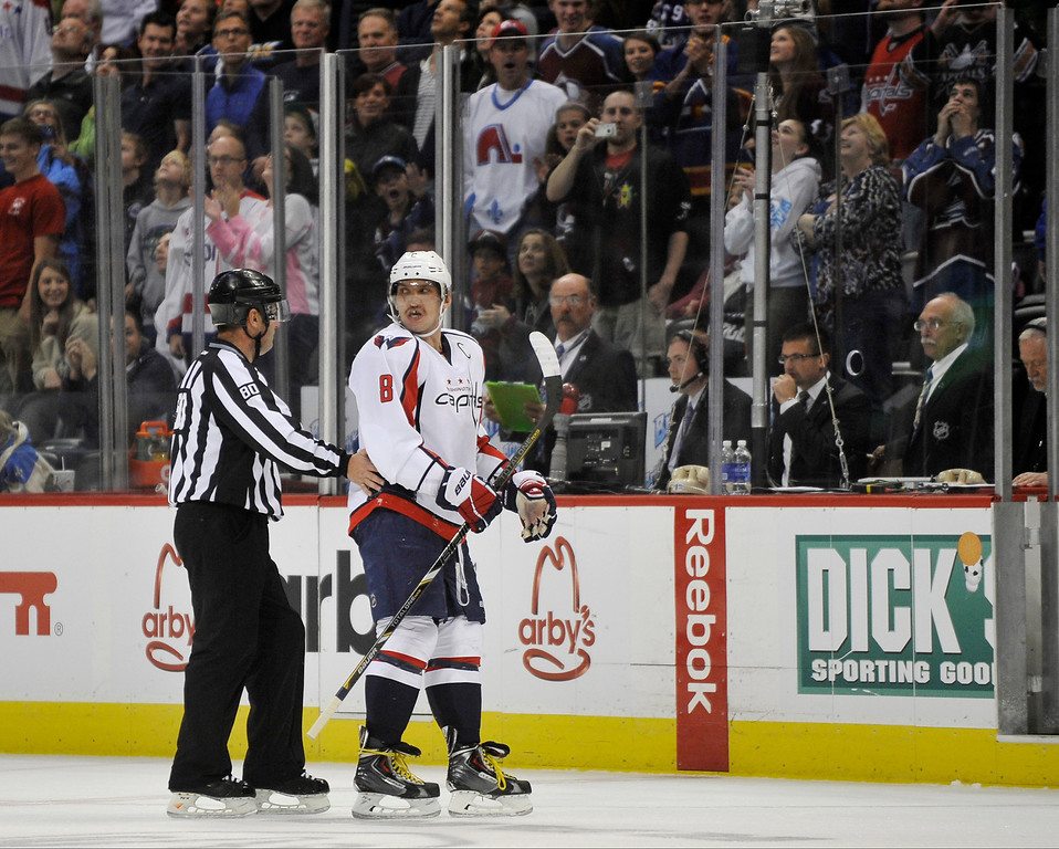 . Washington Capitals forward Alex Ovechkin is escorted to the penalty box during the third period. The Colorado Avalanche hosted the Washington Capitals at the Pepsi Center in Denver, Colorado on Sunday, November 10, 2013. Colorado won 4-1. (Photo By Patrick Traylor/The Denver Post)