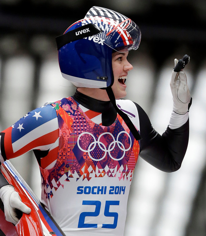 . Summer Britcher of the United States waves to supporters after finishing her first run during the women\'s singles luge competition at the 2014 Winter Olympics, Monday, Feb. 10, 2014, in Krasnaya Polyana, Russia. (AP Photo/Dita Alangkara)