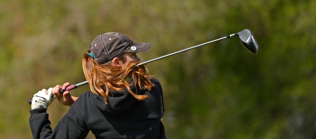 . Mattie Schwall, of Manitou Springs High School, tees off at  hole 11 during the first round of the Colorado State Girls 4A Golf Tournament at Broken Tee Golf Course in Englewood, May 20, 2013. (Photo By RJ Sangosti/The Denver Post)