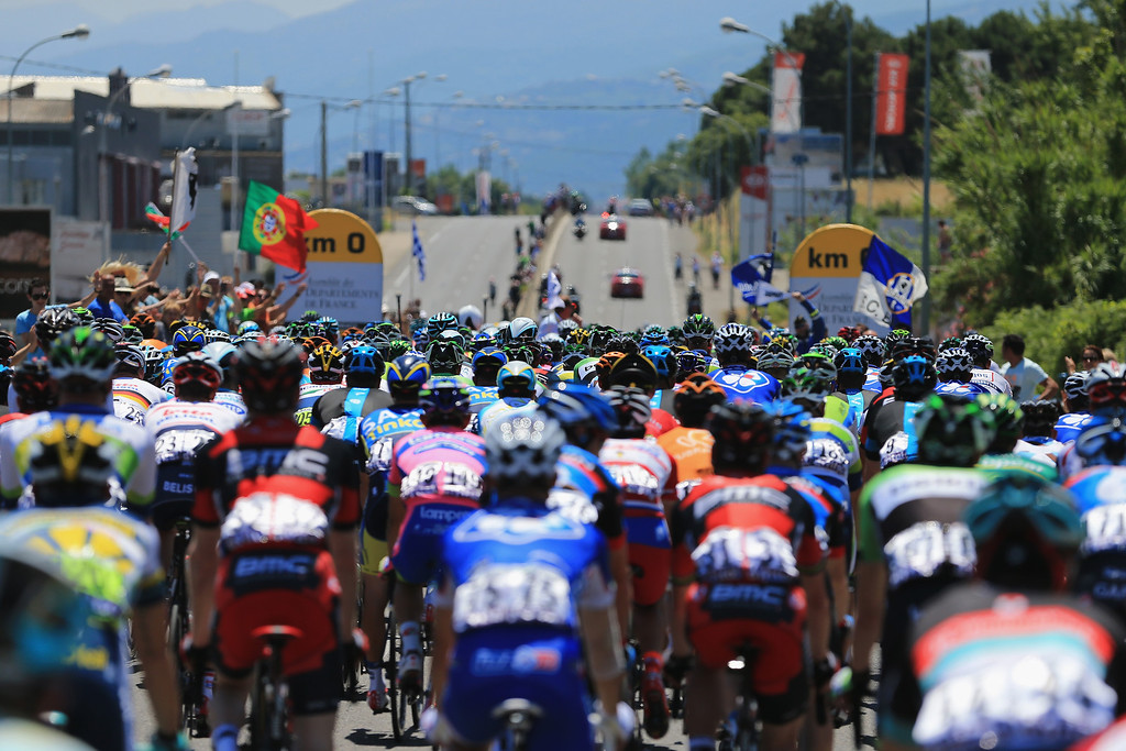 . The peloton arrives at the 0 kilometre mark as they prepare to start stage two of the 2013 Tour de France, a 156KM road stage from Bastia to Ajaccio, on June 30, 2013 in Bastia, France.  (Photo by Doug Pensinger/Getty Images)