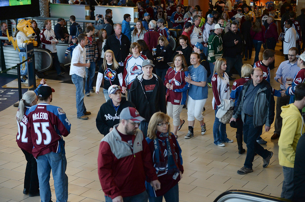 . Avalanche fans head into the stadium before the game.  (Photo by Karl Gehring/The Denver Post)