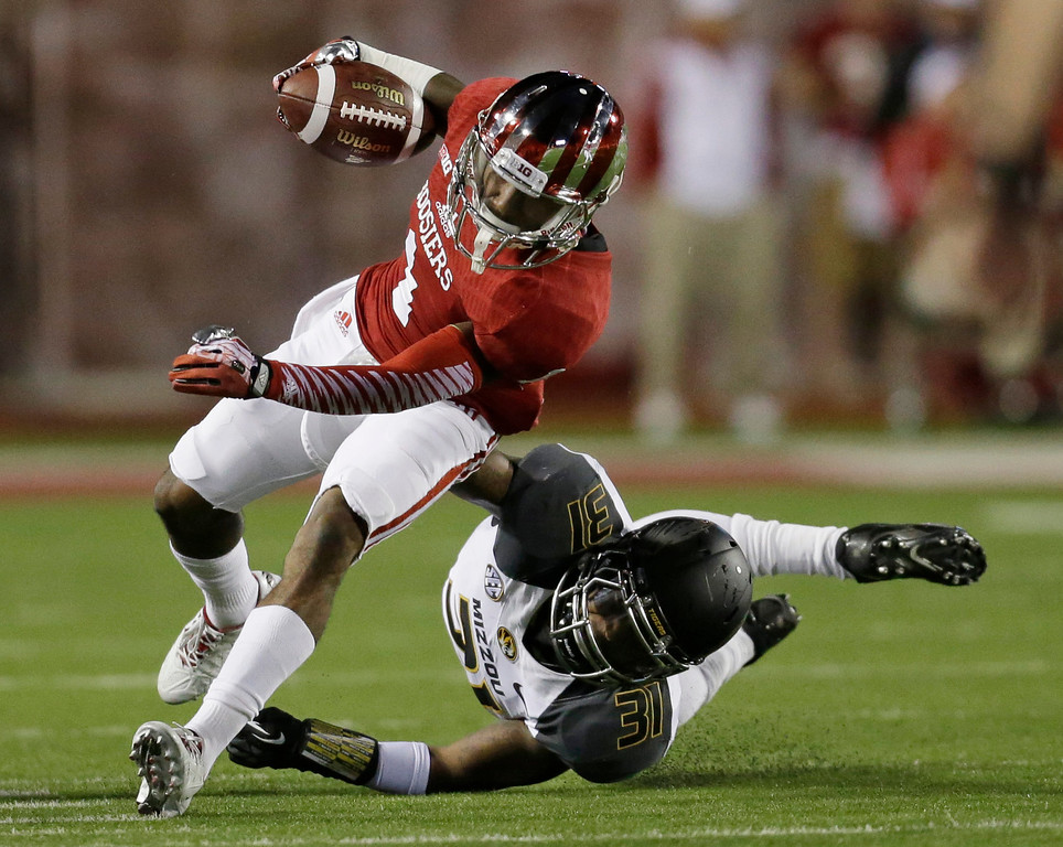 . Indiana\'s Shane Wynn (1) is tackled by Missouri\'s E.J. Gaines (31) during the first half of an NCAA college football game Saturday, Sept. 21, 2013, in Bloomington, Ind.  (AP Photo/Darron Cummings)