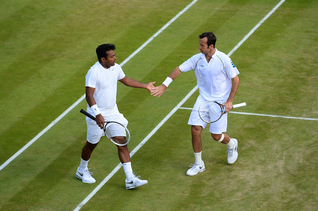 . LONDON, ENGLAND - JULY 04:  Leander Paes of India and Radek Stepanek of Czech Republic celebrate a point during the Gentlemen�s Doubles semi final match against Ivan Dodig of Croatia and Marcelo Melo of Brazil on day ten of the Wimbledon Lawn Tennis Championships at the All England Lawn Tennis and Croquet Club on July 4, 2013 in London, England.  (Photo by Mike Hewitt/Getty Images)
