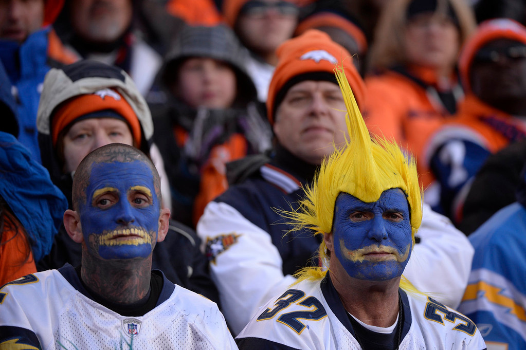 . Charger fans watch from the stands in the second quarter. The Denver Broncos take on the San Diego Chargers at Sports Authority Field at Mile High in Denver on January 12, 2014. (Photo by Craig F. Walker/The Denver Post)