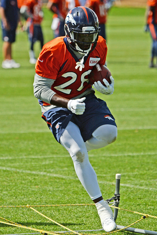 . Montee Ball runs drills during practices at Dove Valley in Centennial, August 21, 2014. The Denver Broncos take on the Houston Texans, in Denver on Saturday, in their third pre-season game. (Photo by RJ Sangosti/The Denver Post)