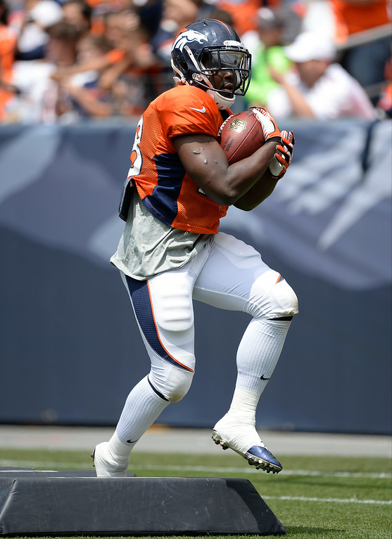 . Denver Broncos running back Montee Ball (28) runs through drills on day four of the Denver Broncos 2014 training camp July 27, 2014 at Sports Authority Field at Mile High. (Photo by John Leyba/The Denver Post)