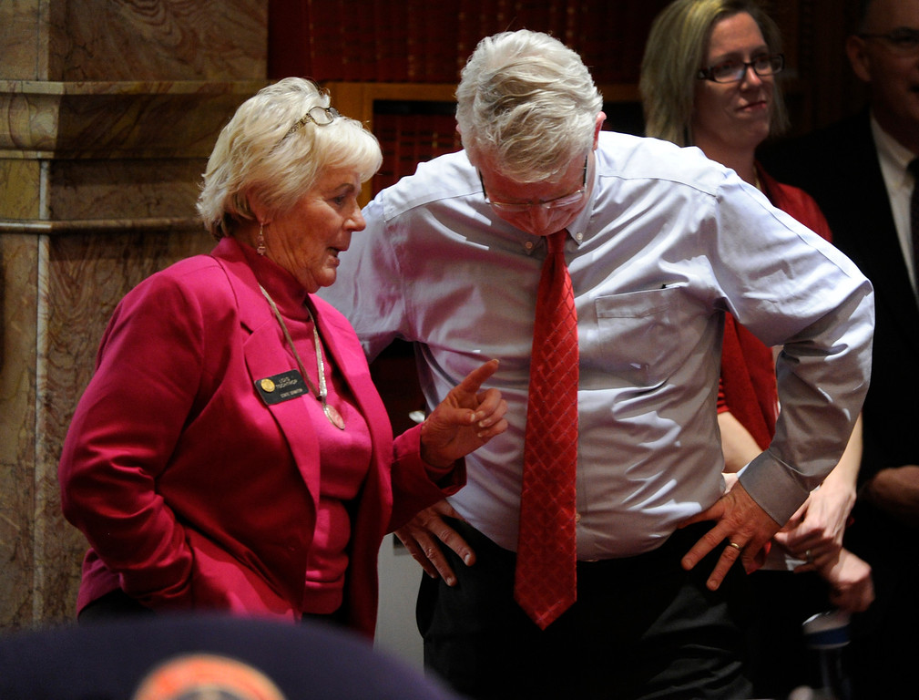 . DENVER, CO. - MARCH 8: State Senator Lois Tochtrop (D-Thornton), left, and Senator Matt Jones (D-Louisville), right, conferred during debate on House Bill 1224 Friday night. The legislation would limit ammunition magazines to 15 rounds. The Colorado Senate continued to debate various gun control measures Friday night, March 8, 2013. (Photo By Karl Gehring/The Denver Post)