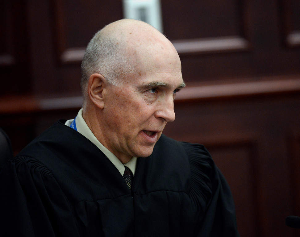 . Judge William Blair Sylvester speaks during the arraignment for James Holmes, where he entered a guilty plea for Holmes, in Centennial, Colo., on Tuesday, March 12, 2013.(AP Photo/Denver Post, RJ Sangosti, Pool)