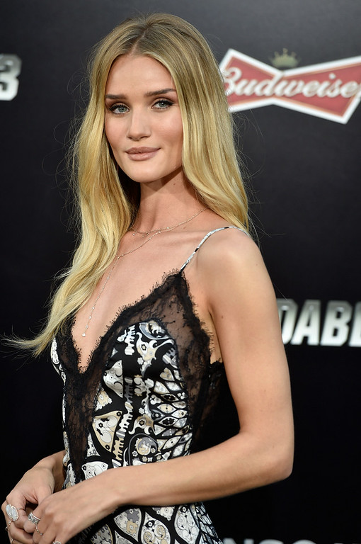 """. Model  Rosie Huntington-Whiteley arrives at the Premiere Of Lionsgate Films\' \""""The Expendables 3\"""" at TCL Chinese Theatre on August 11, 2014 in Hollywood, California.  (Photo by Frazer Harrison/Getty Images)"""