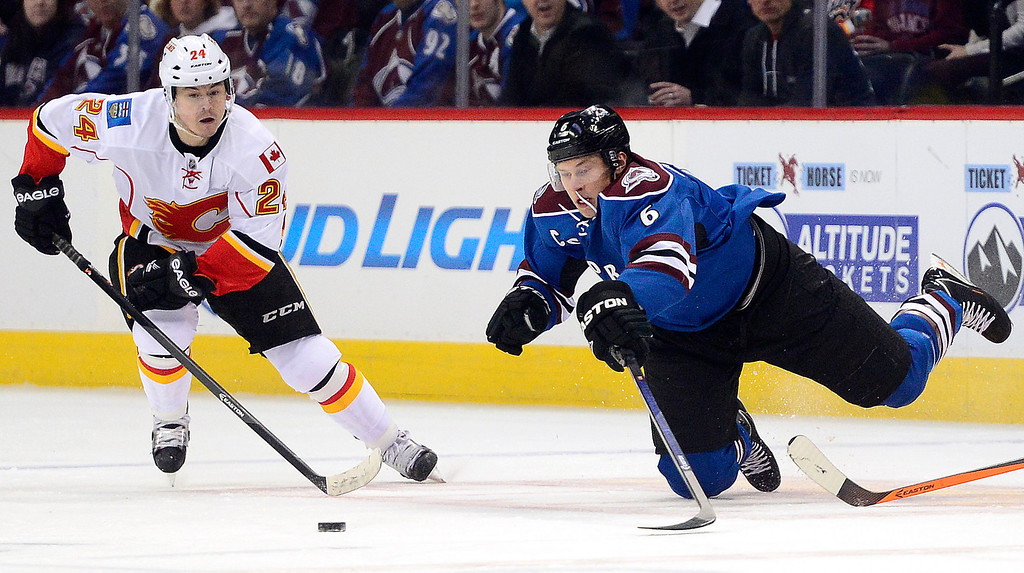 . Erik Johnson (6) of the Colorado Avalanche and Jiri Hudler (24) of the Calgary Flames vie for the puck during the first period.   (Photo by AAron Ontiveroz/The Denver Post)