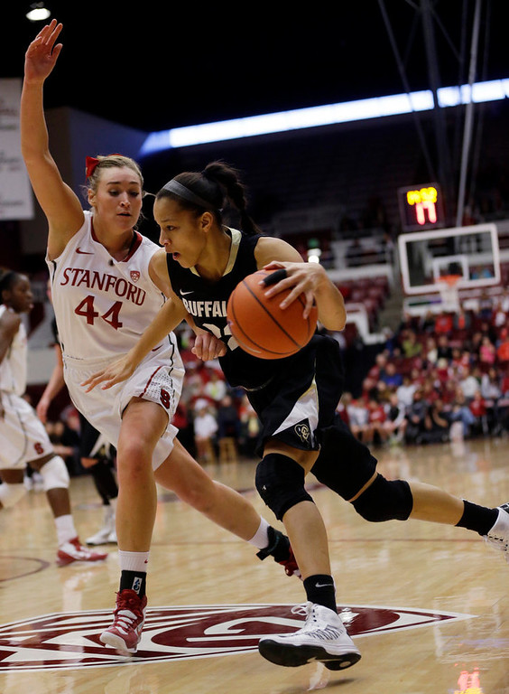 . Colorado \'s Arielle Roberson (32) dribbles past Stanford \'s Joslyn Tinkle (44) during the first half of an NCAA college basketball game in Stanford, Calif., Sunday, Jan. 27, 2013. (AP Photo/Marcio Jose Sanchez)