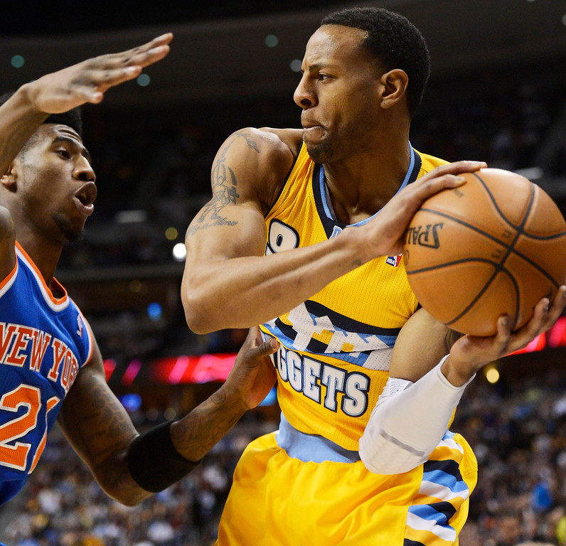 . Andre Iguodala (9) of the Denver Nuggets gets trapped in the corner by Iman Shumpert (21) of the New York Knicks during the first quarter March 13, 2013 at Pepsi Center. (Photo By John Leyba/The Denver Post)