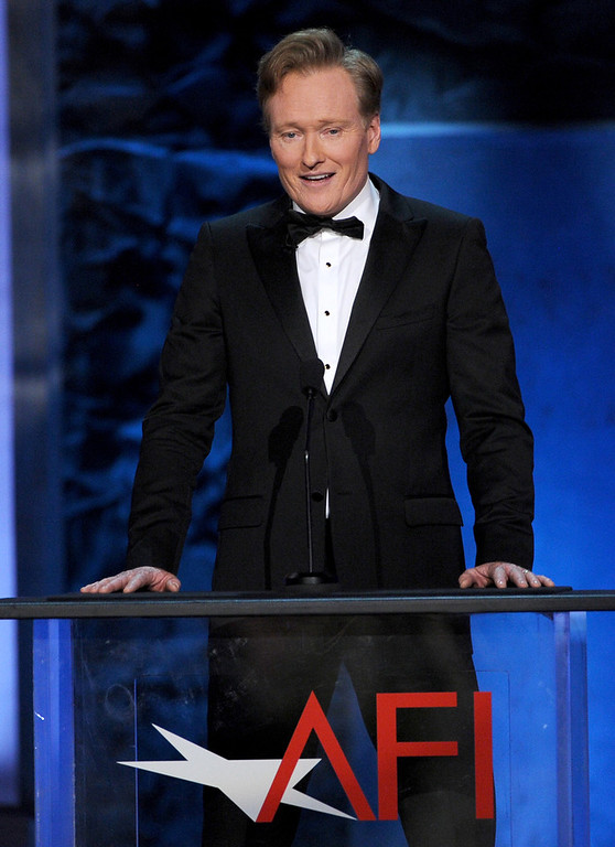 . TV Host Conan O\'Brien speaks onstage during the 41st AFI Life Achievement Award Honoring Mel Brooks at Dolby Theatre on June 6, 2013 in Hollywood, California. Special Broadcast will air Saturday, June 15 at 9:00 P.M. ET/PT on TNT and Wednesday, July 24 on TCM as part of an All-Night Tribute to Brooks.  (Photo by Kevin Winter/Getty Images)