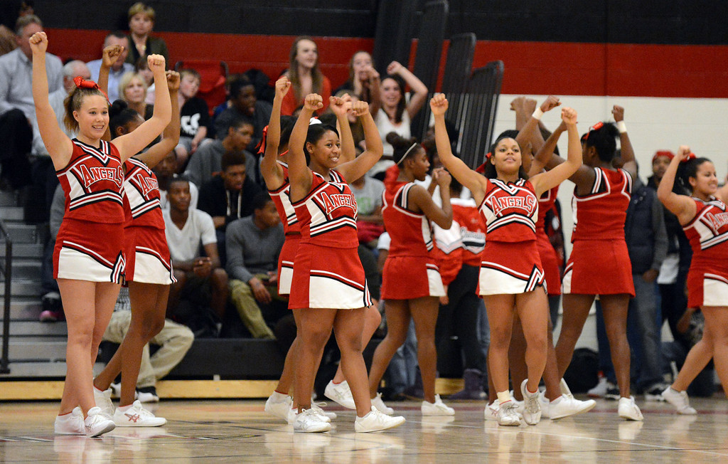 . East High School cheer leaders are in the East High School for the basketball game against Cherry Creek\'s on Friday, Nov. 30, 2012. Hyoung Chang, The Denver Post