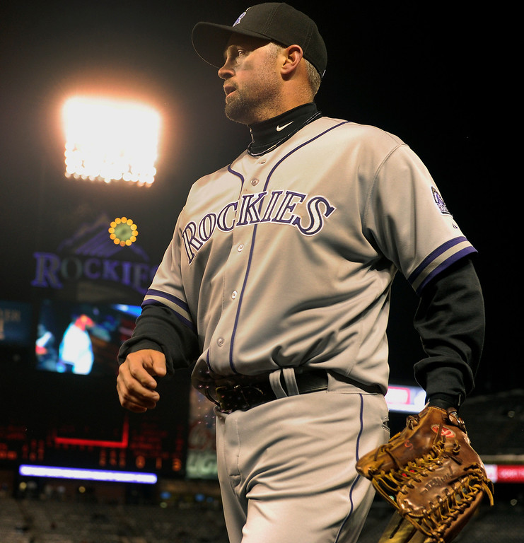 . DENVER, CO. - APRIL 16:  Michael Cuddyer came in from right field Tuesday night. The Colorado Rockies hosted the New York Mets in the second game of a doubleheader Tuesday night, April 16, 2013. Monday night\'s game was snowed out at Coors Field.  Photo By Karl Gehring/The Denver Post)