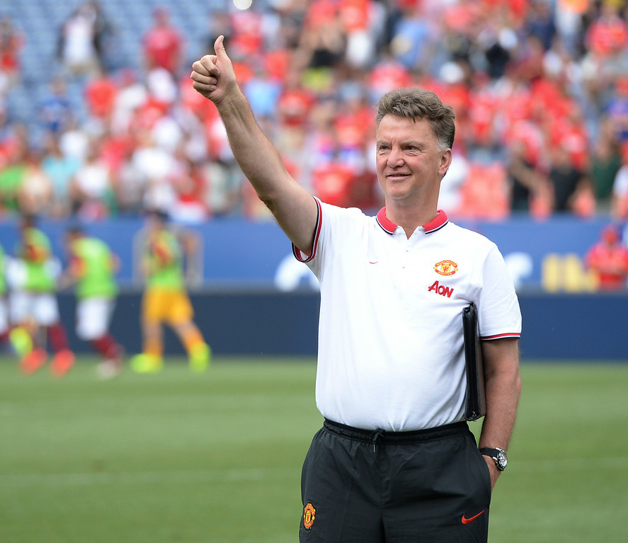 . Manchester United coach Louis van Gaal waved to fans after the win Saturday. Manchester United defeated AS Roma 3-2 in an exhibition soccer game at Sports Authority Field in Denver Saturday afternoon, July 27, 2014. Photo by Karl Gehring/The Denver Post