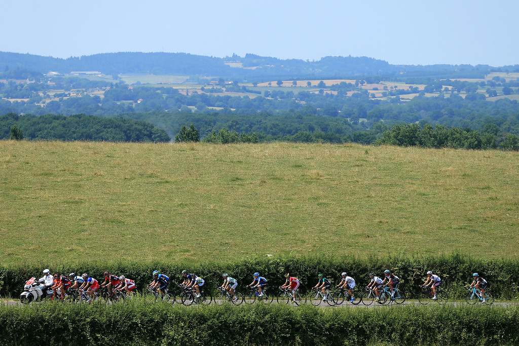 . LYON, FRANCE - JULY 13: A breakaway group of 18 riders form a paceline 50km into stage fourteen of the 2013 Tour de France, a 191KM road stage from Saint-Pourcain-sur-Sioule to Lyon, on July 13, 2013 in Lyon, France.  (Photo by Doug Pensinger/Getty Images)