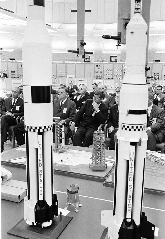 . Models of Saturn rockets frame Kennedy as he is briefed on the country\'s man-on-the-moon program in the Saturn control center at Cape Canaveral, Fla., on Nov. 16, 1963. At his right is James E. Webb, administrator of the National Aeronautics and Space Administration, and at far left is Dr. Kurt Debus, director of NASA\'s Launch Operations Center.  Associated Press file