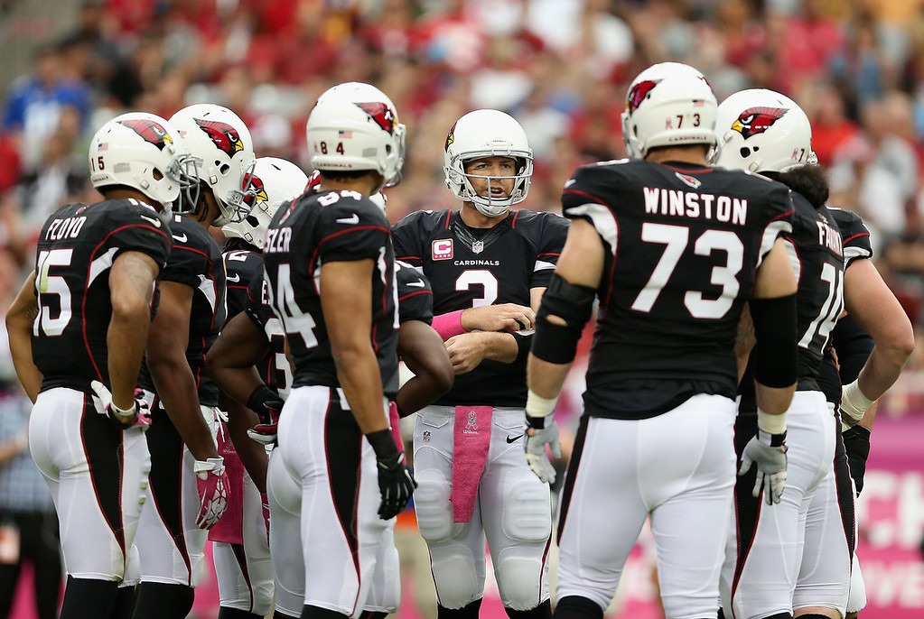 . Quarterback Carson Palmer #3 of the Arizona Cardinals talks with his team in the huddle during the NFL game against the Carolina Panthers at the University of Phoenix Stadium on October 6, 2013 in Glendale, Arizona.  (Photo by Christian Petersen/Getty Images)