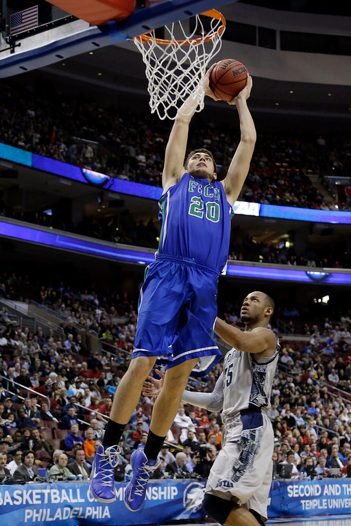 . Florida Gulf Coast\'s Chase Fieler goes up for a dunk against Georgetown\'s Jabril Trawick during the second half of a second-round game of the NCAA college basketball tournament, Friday, March 22, 2013, in Philadelphia. (AP Photo/Matt Rourke)