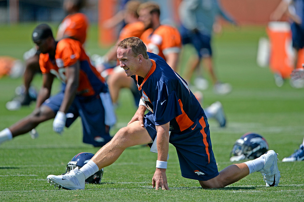 . Denver Broncos quarterback Peyton Manning (18) stretches during day two of the Denver Broncos 2014 training camp July 25, 2014 at Dove Valley. (Photo by John Leyba/The Denver Post)