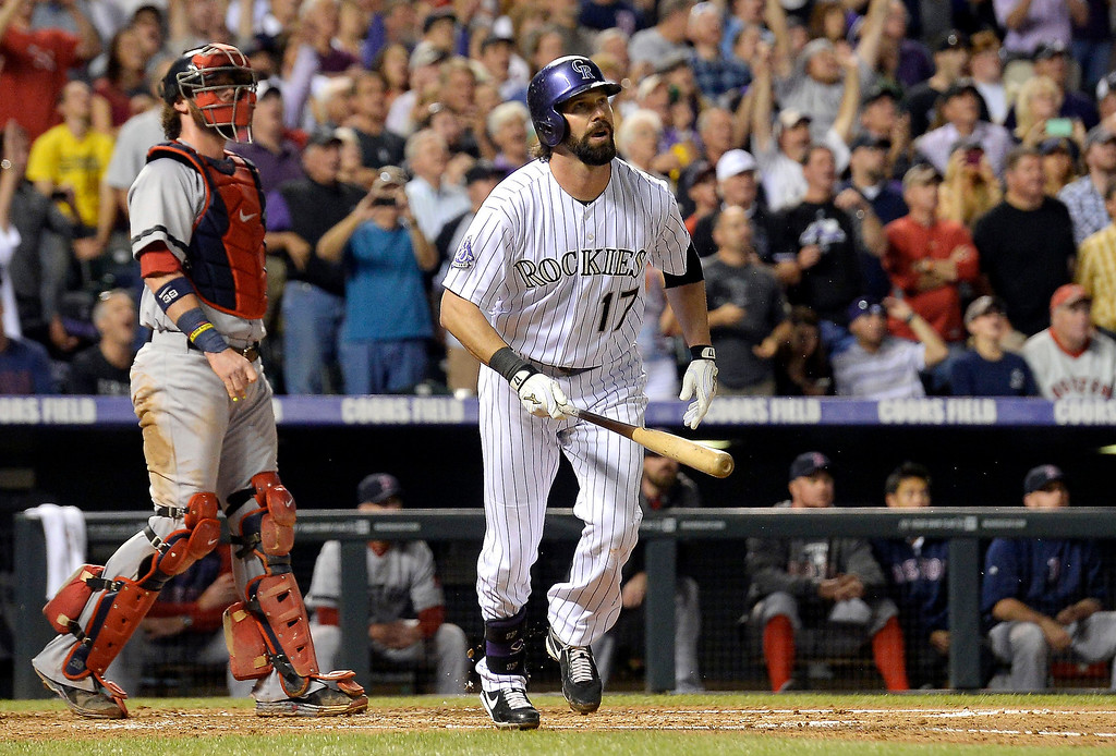 . Todd Helton (17) of the Colorado Rockies watches his home run sail over the wall off of Boston Red Sox starting pitcher Jake Peavy (44) of the Boston Red Sox in the second inning September 25, 2013 at Coors Field. (Photo By John Leyba/The Denver Post)
