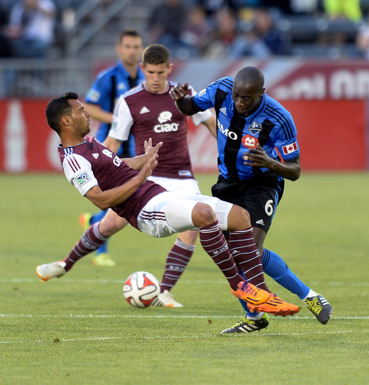 . Montreal defender Hassoun Camara (6) collided with Colorado midfielder Kamani Hill (13) in the first half. The Colorado Rapids hosted the Montreal Impact Saturday night, May 24, 2014. (Photo by Karl Gehring/The Denver Post)