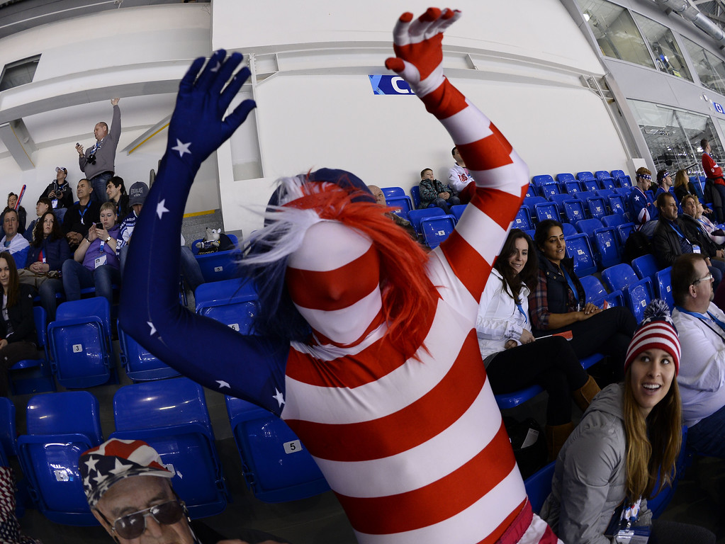 . A US Ice Hockey supporter cheers his team prior to the Women\'s Ice Hockey Group A match Canada vs USA at the Shayba Arena during the Sochi Winter Olympics on February 12, 2014. JONATHAN NACKSTRAND/AFP/Getty Images