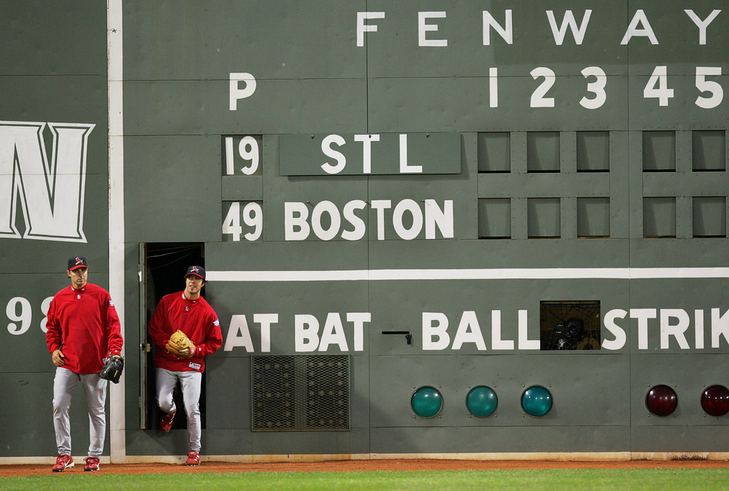 ". St. Louis Cardinals\' Matt Morris, left, and Danny Haren emerge from inside the ""Green Monster\"" wall in left field at Fenway Park in Boston, Friday Oct. 22, 2004 during a team workout. The Cardinals are preparing for Saturday\'s Game 1 of the World Series against the Boston Red Sox. (AP Photo/Winslow Townson)"