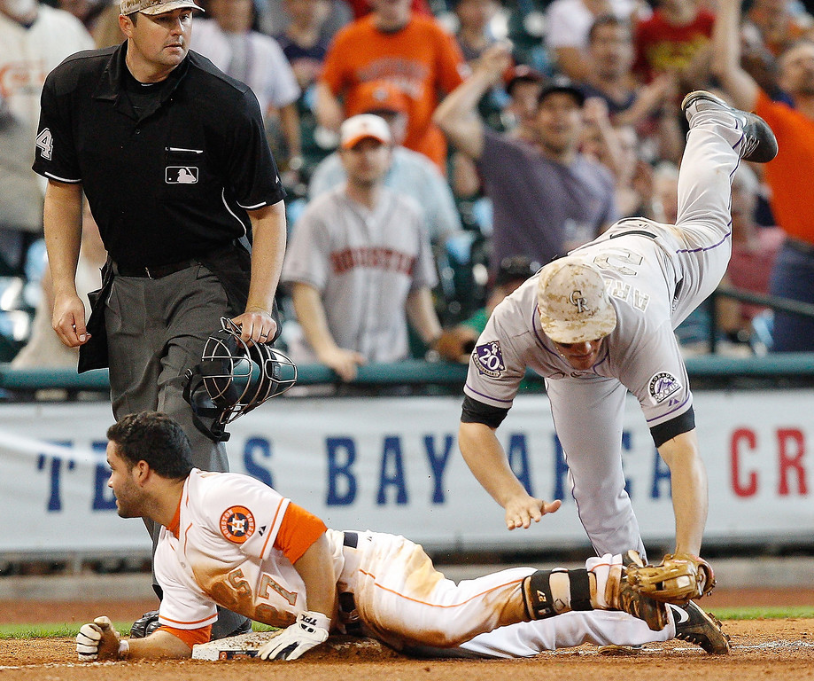 . Nolan Arenado of the Colorado Rockies tags out Houston Astros\' Jose Altuve on May 27, 2013, in Houston. (AP Photo/Bob Levey)