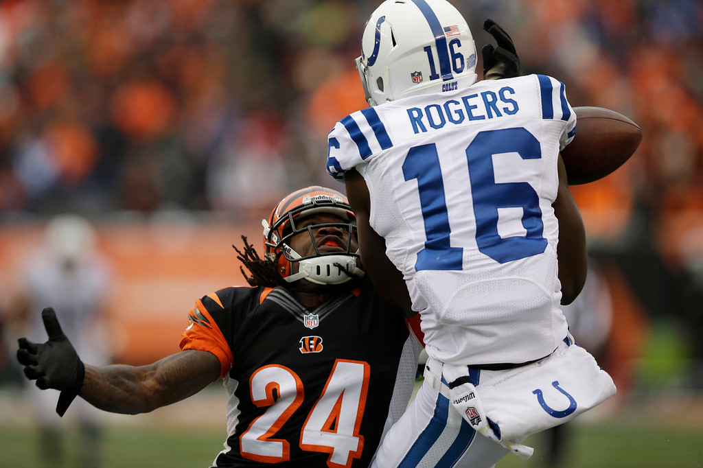 . Cincinnati Bengals cornerback Adam Jones (24) breaks up a pass intended for Indianapolis Colts wide receiver Da\'Rick Rogers (16) in the first half of an NFL football game, Sunday, Dec. 8, 2013, in Cincinnati. (AP Photo/Al Behrman)