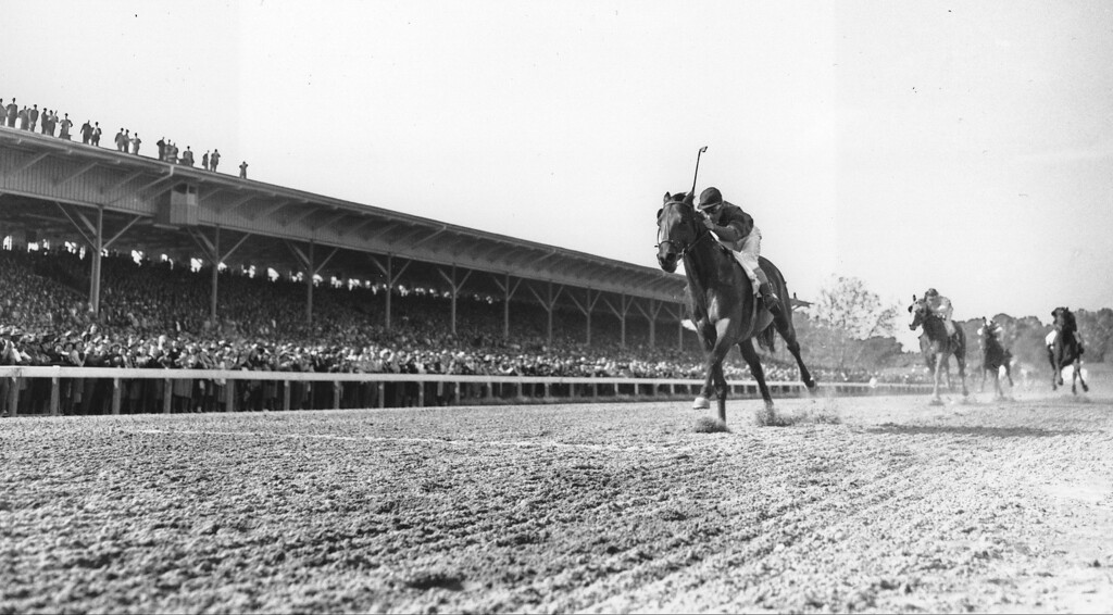 . 1948: CITATION - Citation,  ridden by Eddie Arcaro,  races home an easy winner in the $100,000 added Belmont Stakes Race and the Triple Crown at Belmont Park in Elmont, N.Y., in 1948 photo.  (AP Photo)