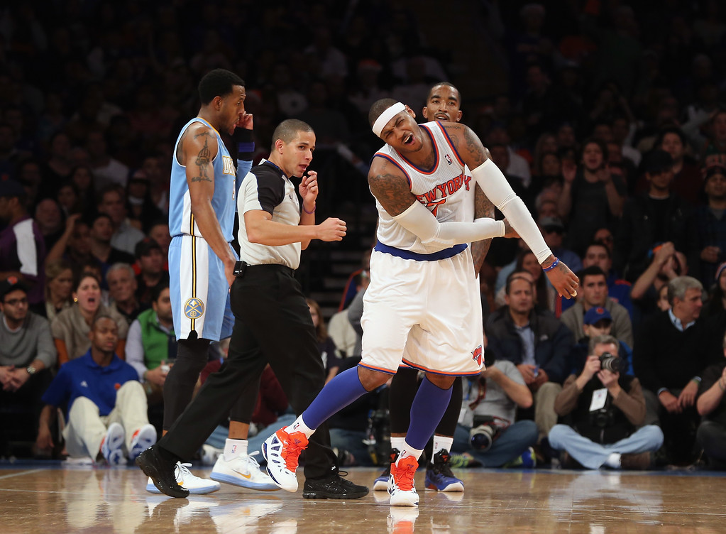. Carmelo Anthony #7 of the New York Knicks reacts after taking a foul against the Denver Nuggets and is givena  technical foul at Madison Square Garden on December 9, 2012 in New York City.  The Knicks defeated the Nuggets 112-106.  (Photo by Bruce Bennett/Getty Images)
