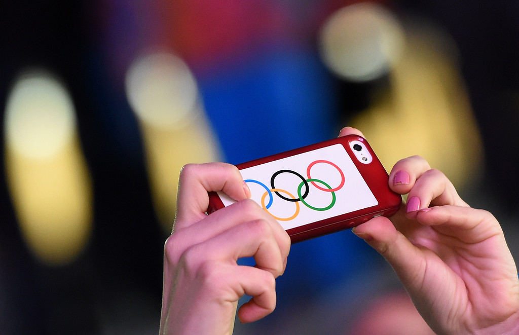 . An Olympic fan takes a photo at the Men\'s Luge final at the Sanki Sliding Center during the Sochi Winter Olympics on February 9, 2014.   LEON NEAL/AFP/Getty Images