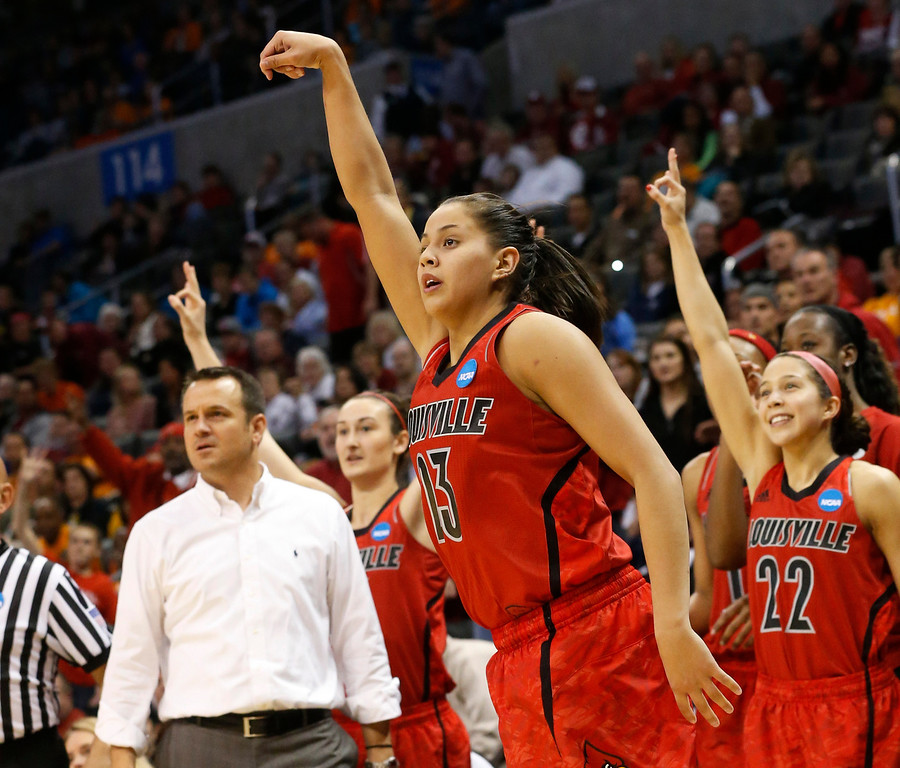 . Louisville guard Shoni Schimmel (23) and the Louisville bench react to her 3-point shot against Tennessee in the second half of the regional final in the NCAA women\'s college basketball tournament in Oklahoma City, Tuesday, April 2, 2013. Louisville won 86-78. (AP Photo/Sue Ogrocki)