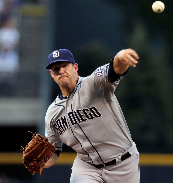 . San Diego Padres starting pitcher Eric Stults delivers to the Colorado Rockies  in the first inning of a baseball game in Denver on Tuesday, Aug. 13, 2013.(AP Photo/Joe Mahoney)