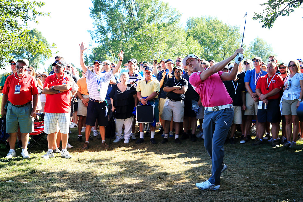 . ROCHESTER, NY - AUGUST 10:  Jonas Blixt of Sweden plays a shot from the rough after taking hitting a wayward tee shot that landed in the pocket of Muhammad Khokhar of Rochester on the 18th hole during the third round of the 95th PGA Championship on August 10, 2013 in Rochester, New York.  (Photo by David Cannon/Getty Images)