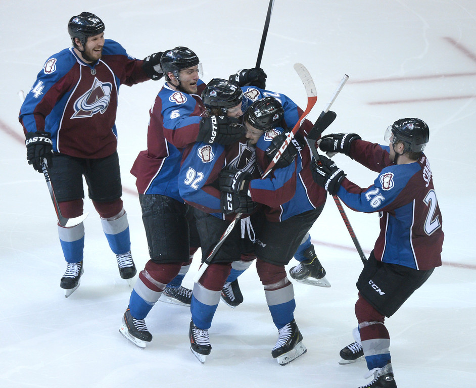 . DENVER, CO - APRIL 24: Teammates mobbed Colorado center Nathan MacKinnon after he scored in overtime to give the Avalanche a 4-3 win Saturday night. The Colorado Avalanche hosted the Minnesota Wild in the fifth game of a playoff series Saturday night, April 26, 2014. (Photo by Karl Gehring/The Denver Post)