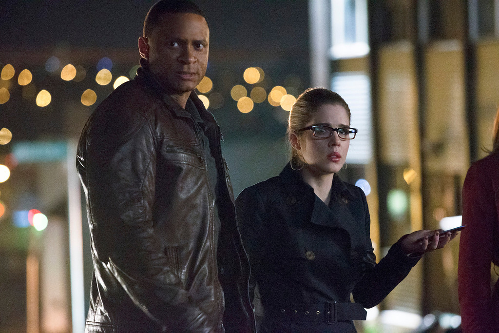 ". David Ramsey as John Diggle and Emily Bett Rickards as Felicity Smoak in The CW\'s ""Arrow.\""  (Photo by Jack Rowand/The CW -- © 2014 The CW Network, LLC. All Rights Reserved.)"