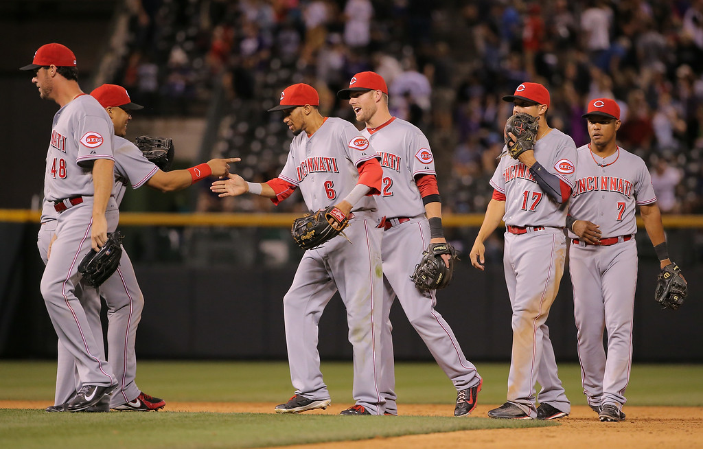 . DENVER, CO - AUGUST 15:  The Cincinnati Reds celebrate their 3-2 victory over the Colorado Rockies at Coors Field on August 15, 2014 in Denver, Colorado.  (Photo by Doug Pensinger/Getty Images)