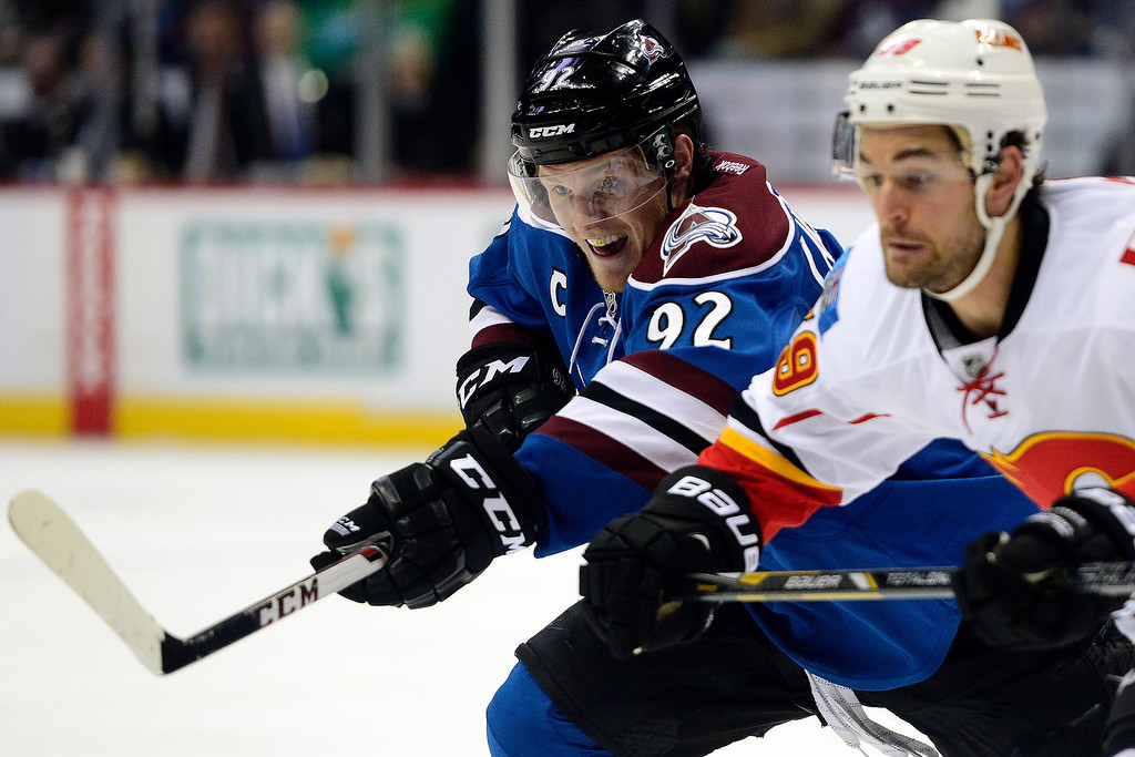 . Gabriel Landeskog (92) of the Colorado Avalanche and T.J. Galiardi (39) of the Calgary Flames wait for a faceoff during the third period of the Flames\' 4-3 win. (Photo by AAron Ontiveroz/The Denver Post)