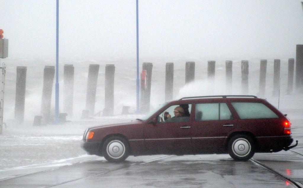 . A car drives to the ferry dock at the North Sea coast in Dagebuell,Germany, on December 5, 2013.    AFP PHOTO / DPA / CARSTEN REHDER  /AFP/Getty Images