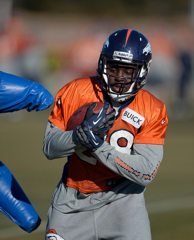 . Denver Broncos running back Montee Ball (28) runs through drills during practice January 2, 2014 at Dove Valley (Photo by John Leyba/The Denver Post)