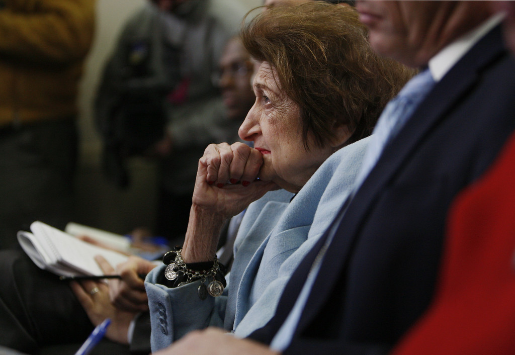 """. In this Feb. 25, 2009, file photo veteran White House correspondent Helen Thomas listens as White House Press Secretary Robert Gibbs answers her question during his daily press briefing in Washington. Thomas, the irrepressible White House correspondent who used her center, front row seat of history to grill 10 presidents, died Saturday, July 20, 2013, at the age of 92. She pushed open the doors for women at the White House Correspondents\' Association dinner, when at her urging, President John F. Kennedy refused to attend the 1962 dinner unless it was open to women for the first time. Thomas fought, too, for a more open presidency, resisting all moves by a succession of administrations to restrict press access. \""""People will never know how hard it is to get information,\"""" she told an interviewer, \""""especially if it\'s locked up behind official doors where, if politicians had their way, they\'d stamp TOP SECRET on the color of the walls.\"""" (AP Photo/Charles Dharapak, File)"""